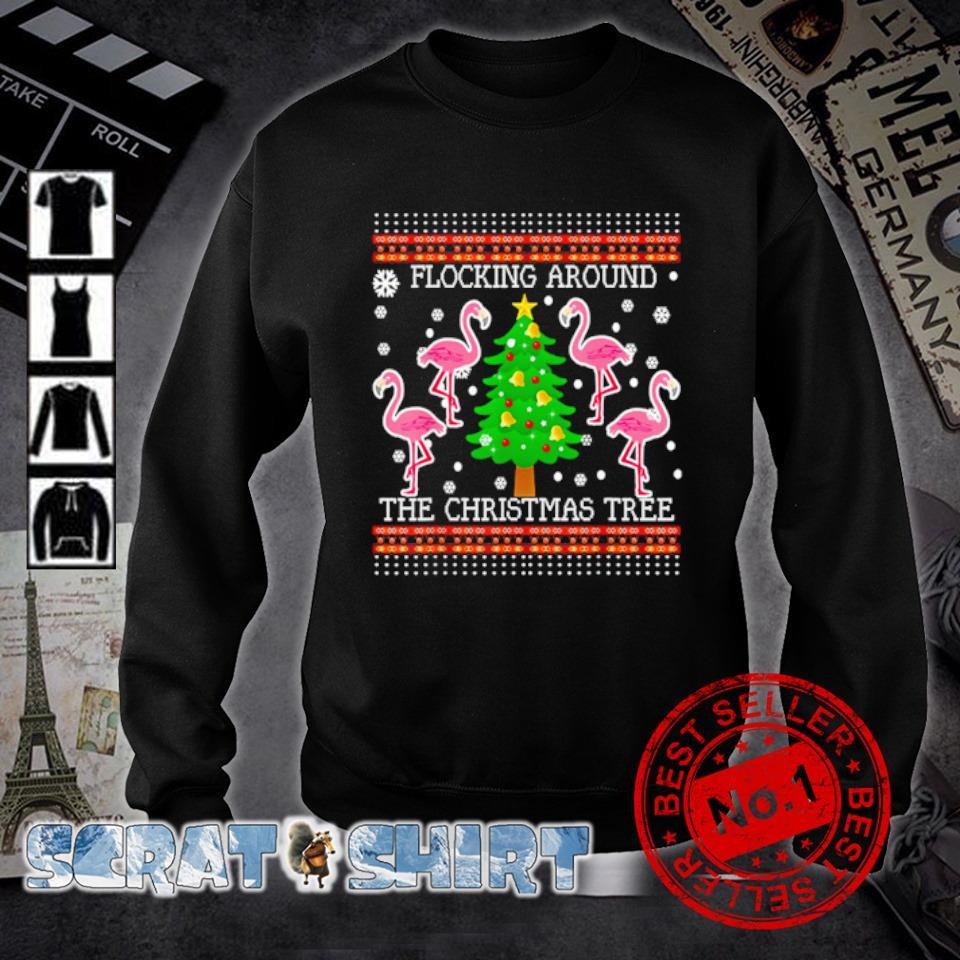 Flamingos flocking around the Christmas tree s sweater
